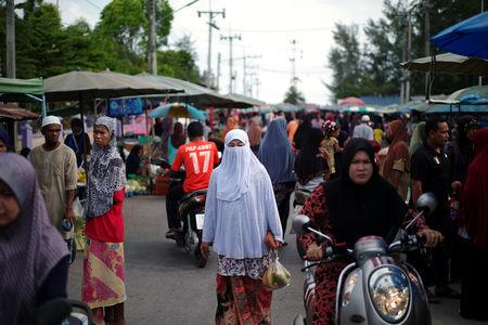 A Muslim woman walks at a market in Pattani province in Thailand's Deep South region, Thailand, March 16, 2019. REUTERS/Panu Wongcha-um
