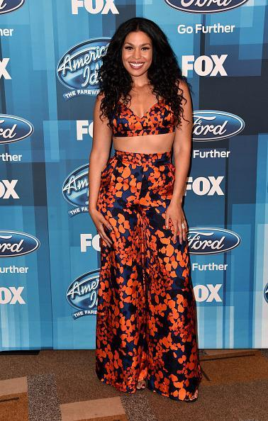 <p>Jordin Sparks showed off her toned tummy in a crop top bra and matching wide-leg floral pants. <i>(Photo: Getty Images)</i></p>