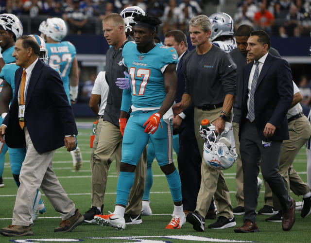 Team staff assist Miami Dolphins' Allen Hurns (17) off the field after he suffered an unknown injury in the first half of a NFL football game against the Dallas Cowboys in Arlington, Texas, Sunday, Sept. 22, 2019. (AP Photo/Michael Ainsworth)