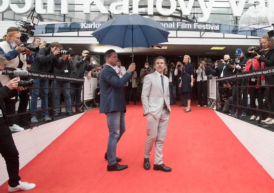 <p>Ethan Hawke gets an escort on Aug. 27 at the screening of his film <em>First Reformed </em>at the 55th Karlovy Vary International Film Festival in the Czech Republic.</p>