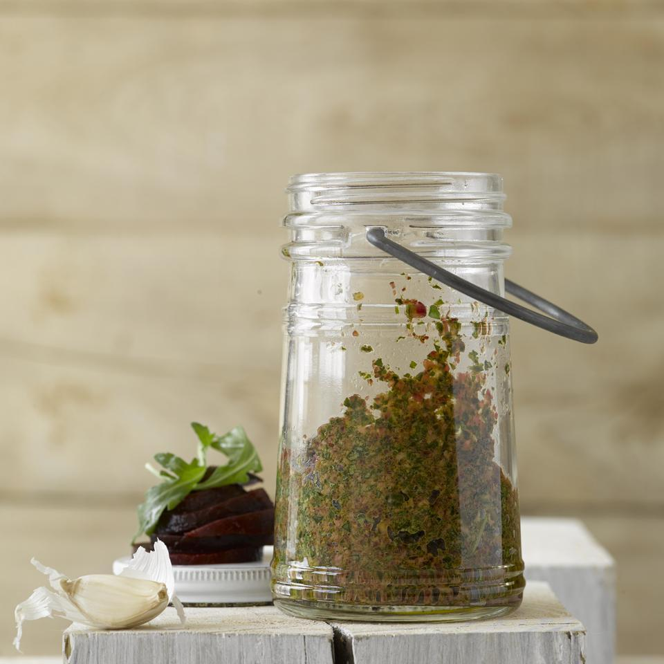 <p>Sweet beets, peppery arugula and toasted pecans are blended together in this dairy-free, healthy pesto recipe. Try it spread on crostini or spooned over grilled chicken or pork.</p>