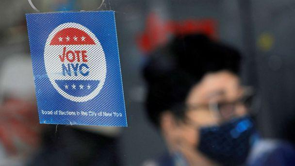 PHOTO: Signage is seen at an early voting location in Harlem ahead of the New York City mayoral primary on June 18, 2021. (Andrew Kelly/Reuters)