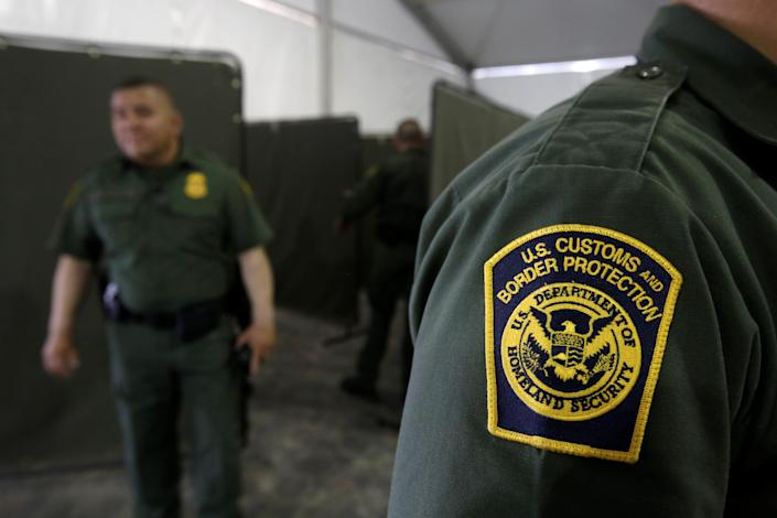 US Border Patrol agents are seen during a tour of US Customs and Border Protection (CBP) temporary holding facilities in El Paso, Texas, in May 2019 (REUTERS)