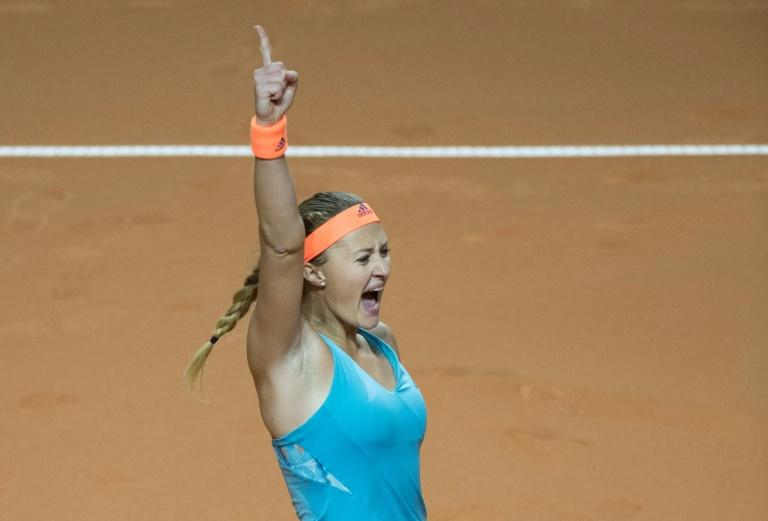 France's Kristina Mladenovic reacts after defeating Russia's Maria Sharapova in the semi-final match at the WTA Tennis Grand Prix in Stuttgart, southwestern Germany, on April 29, 2017