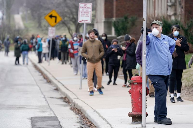 Voters masked against coronavirus line up at Riverside High School for Wisconsin's primary election, April 7 in Milwaukee. (Photo: ASSOCIATED PRESS)