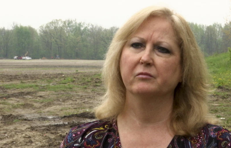 """In a frame from video Konnie Beyma is interviewed near the excavation site in Macomb Township, Mich., Monday, May 14, 2018, where police have resumed digging in an area that might yield the remains of several missing girls. Beyma's sister, Kimberly King, disappeared in 1979 at age 12. Beyma says police believe they """"are very close"""" to finding remains. The search began after police interviewed a prisoner locked up for the slaying of a 13-year-old girl whose remains were found in 2008 near the same area. (AP Photo/Mike Householder)"""