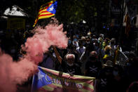 Pro-independence demonstrators gather during a protest against Spain's prime minister Pedro Sanchez outside the Gran Teatre del Liceu in Barcelona, Spain, Monday, June 21, 2021. Sanchez's said Monday that the Spanish Cabinet will approve pardons for nine separatist Catalan politicians and activists imprisoned for their roles in the 2017 push to break away from Spain. (AP Photo/Joan Mateu)