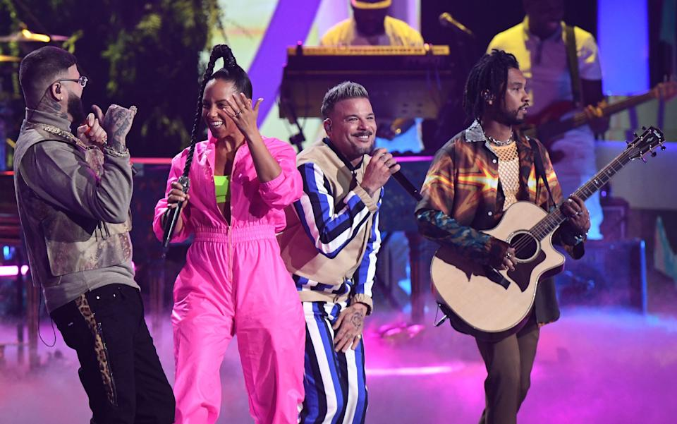 """Farruko, left, Alicia Keys, Pedro Capo and Miguel perform a feel-goodperformance of """"Calma""""  during the 20th Annual Latin Grammy Awards."""