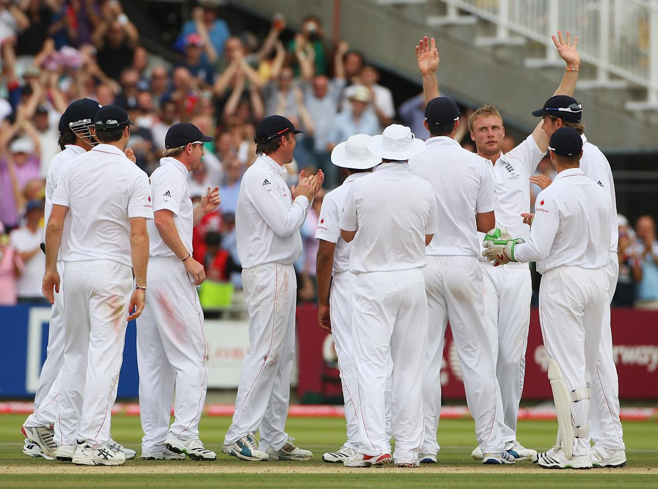 LONDON - JULY 20:  Andrew Flintoff of England celebrates the wicket of Peter Siddle of Australia with team mates during day five of the npower 2nd Ashes Test Match between England and Australia at Lord's on July 20, 2009 in London, England.  (Photo by Tom Shaw/Getty Images)