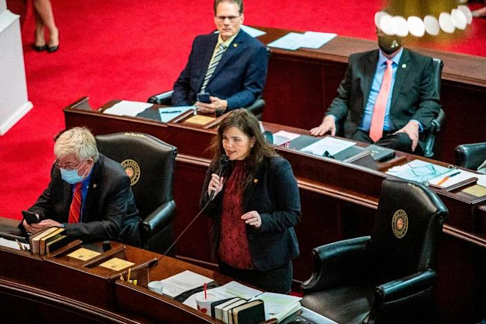 Watauga Republican Sen. Deanna Ballard, center, speaks on the Senate floor prior to a failed veto override vote on SB 37, the schools reopening bill Gov. Cooper vetoed, Monday, March 1, 2021 at North Carolina General Assembly. Some North Carolina schools have been remote-only for nearly a year.