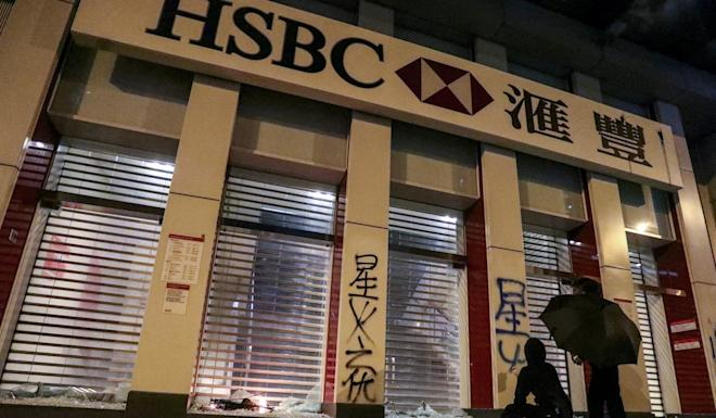 HSBC says it is 'saddened and disappointed by the acts of vandalism' at its Mong Kok branch. Photo: May Tse