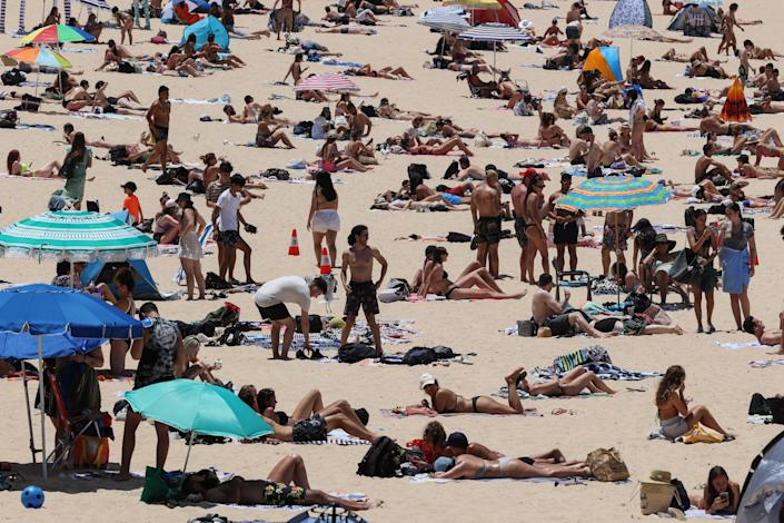 <p>Beachgoers enjoy a summer day at Coogee Beach in Sydney</p> (REUTERS)
