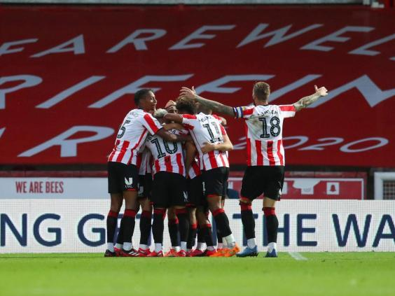 Bryan Mbeumo (obscured) of Brentford celebrates with his team mates (Getty Images)