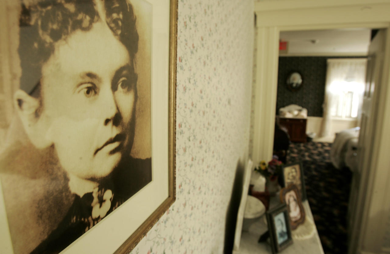 **FILE** In this Aug. 20, 2008, file photo, a photograph of Lizzie Borden hangs on a wall in the Lizzie Borden  Bed and Breakfast, in Fall River, Mass. A new museum and shop using the Lizzie Borden name in Salem, Mass., will change its name to settle a trademark infringement case. The agreement reached Monday, Oct. 6, 2008, allows the owner of the inn to continue using the Lizzie Borden name on his business. (AP Photo/Steven Senne)