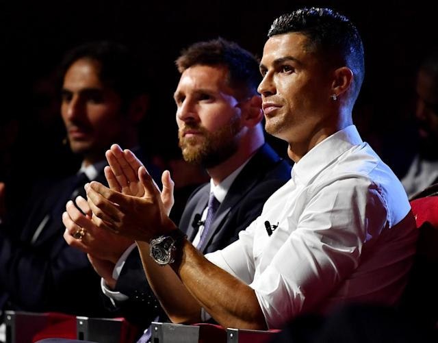 Cristiano Ronaldo and Lionel Messi didn't have much reason to smile after the Champions League group stage draw. (Getty)