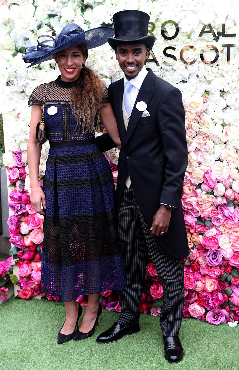<p>Mo Farah and his wife, Tania Bell, attended this year's Royal Ascot. For the prestigious ceremony, Tania played by the rules in a navy-hued dress and co-ordinating hat. Meanwhile, Farah looked dapper in a top hat and morning suit. <em>[Photo: PA]</em> </p>