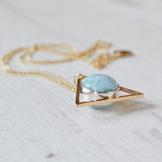 """<a href=""""https://www.etsy.com/listing/286456923/moonstone-and-larimar-two-faced-triangle?ref=finds_hl"""" target=""""_blank"""">Get it here</a>."""