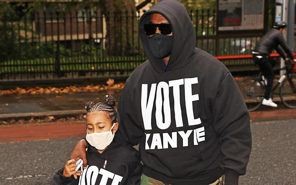 Kanye West with his daughter North, in London on October 9 - Getty