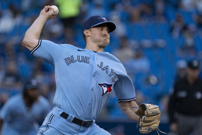 Toronto Blue Jays pitcher Ross Stripling throws to a Kansas City Royals batter during the first inning of a baseball game Friday, July 30, 2021, in Toronto. The Blue Jays were playing in Toronto for the first time since the COVID-19 pandemic began.(Peter Power/The Canadian Press via AP)