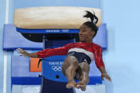 FILE - In this July 27, 2021 file photo, Simone Biles, of the United States, performs on the vault during the artistic gymnastics women's final at the 2020 Summer Olympics, in Tokyo. Biles and Naomi Osaka are prominent young Black women under the pressure of a global Olympic spotlight that few human beings ever face. But being a young Black woman -- which, in American life, comes with its own built-in pressure to perform -- entails much more than meets the eye. (AP Photo/Natacha Pisarenko, File)
