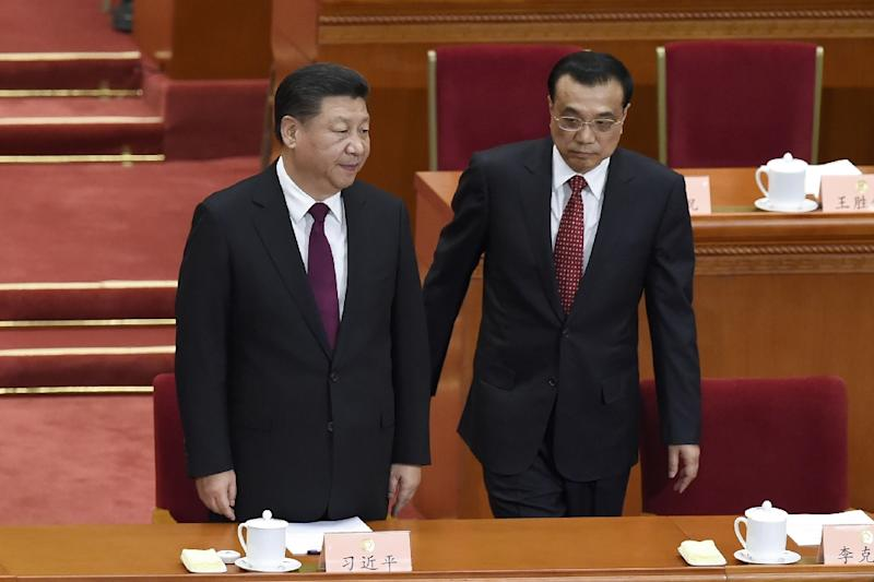 China's President Xi Jinping (L) and Premier Li Keqiang arrive for the opening session of the China's People's Political Consultative Conference (CPPCC) at the Great Hall of the People in Beijing on March 3, 2017