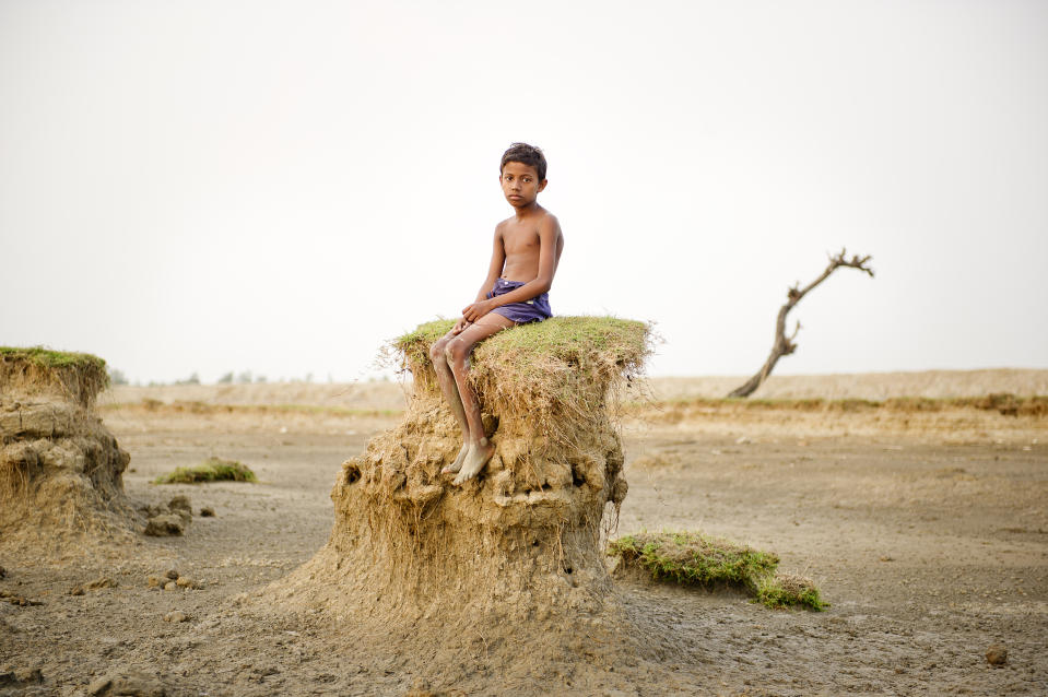 """Ghoramara island is located on a delta region in West Bengal. Due to the dramatic increase in sea level, resulting from the effects global warming since the 1960s, the shores of this island are being perpetually washed away. Since the 1980s more than 50% of the territory has vanished due to erosion by the sea. Many of the people still living on the island are farmers and fishermen who depend on the island's resources for their livelihoods. (Daesung Lee, Korea, Finalist, Contemporary Issues, Professional Competition, 2013 Sony World Photography Awards/SIPA Press) <br> <br> <a href=""""http://worldphoto.org/about-the-sony-world-photography-awards/"""" rel=""""nofollow noopener"""" target=""""_blank"""" data-ylk=""""slk:Click here to see the full shortlist at World Photography Organisation"""" class=""""link rapid-noclick-resp"""">Click here to see the full shortlist at World Photography Organisation</a>"""