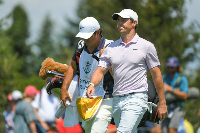 JERSEY CITY, NJ - AUGUST 09: Rory McIlroy of Northern Ireland and his caddie walk off the fifth tee box during the second round of THE NORTHERN TRUST at Liberty National Golf Club on August 9, 2019 in Jersey City, New Jersey. (Photo by Ben Jared/PGA TOUR via Getty Images)
