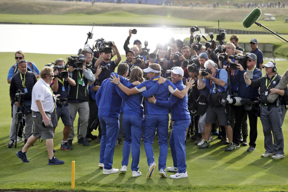 FILE- In this Sept. 30, 2018, file photo, from left, Europe's Justin Rose, Tommy Fleetwood, Ian Poulter and Paul Casey pose for photographers as they celebrate after Europe won the Ryder Cup on the final day of the 42nd Ryder Cup at Le Golf National in Saint-Quentin-en-Yvelines, outside Paris, France. The pandemic-delayed 2020 Ryder Cup returns the United States next week at Whistling Straits along the Wisconsin shores of Lake Michigan. (AP Photo/Matt Dunham, File)