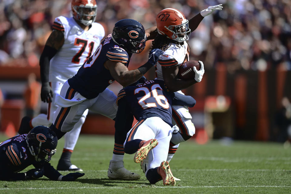Cleveland Browns running back Kareem Hunt (27) rushes for a first down during the first half of an NFL football game against the Chicago Bears, Sunday, Sept. 26, 2021, in Cleveland. (AP Photo/David Dermer)