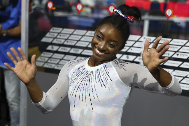 Gold medal winner Simone Biles of the U.S. celebrates after the women's all-around final at the Gymnastics World Championships in Stuttgart, Germany, Thursday, Oct. 10, 2019. (AP Photo/Matthias Schrader)