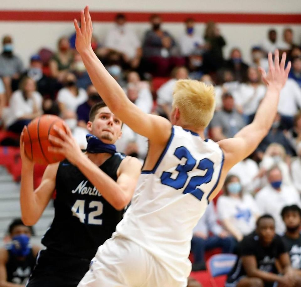North Forney center Gavin Sterling (42) looks to shoot against Joshua center Noah Smith (32) during the second half of a 5A region 2 bi-district basketball game at Grapevine High School in Grapevine, Texas, Tuesday, Feb. 23, 2021. North Forney defeated Joshua 61-50. (Special to the Star-Telegram Bob Booth)