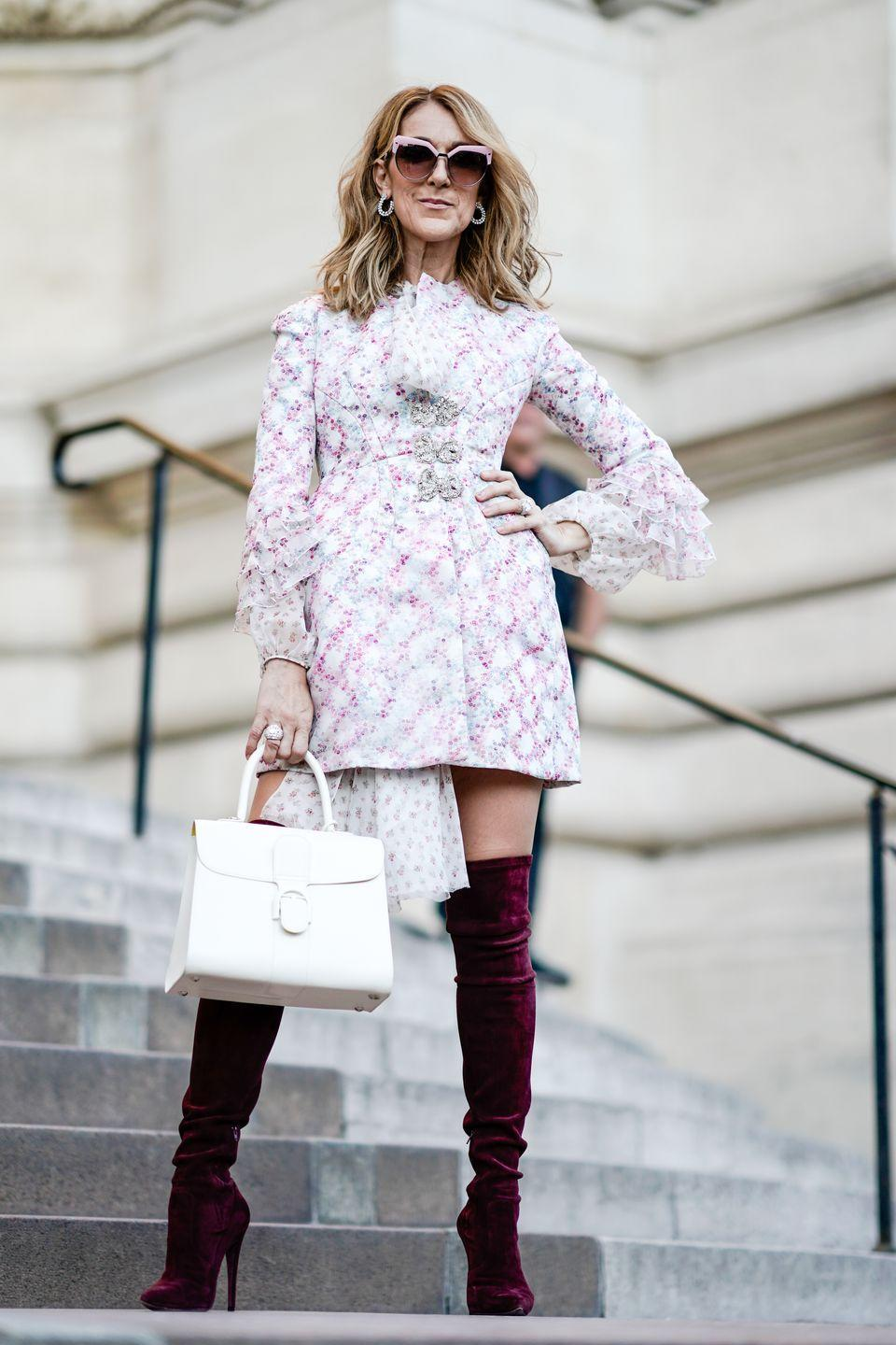 <p>At Paris Couture Week, Dion stunned in a Giambattista Valli dress and over-the-knee boots while attending the designer's show. </p>
