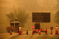 Cones block the entrance to Sequoia National Park, Calif., as the KNP Complex Fire burns nearby on Wednesday, Sept. 15, 2021. The blaze is burning near the Giant Forest, home to more than 2,000 giant sequoias. (AP Photo/Noah Berger)