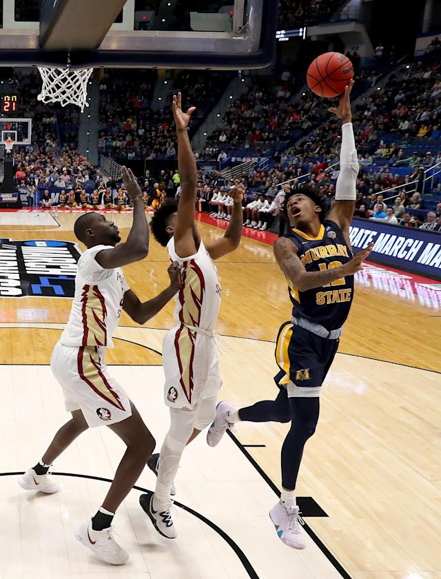 <p>Ja Morant #12 of the Murray State Racers attempts a shot against the Florida State Seminoles in the first half during the second round of the 2019 NCAA Men's Basketball Tournament at XL Center on March 23, 2019 in Hartford, Connecticut. (Photo by Rob Carr/Getty Images) </p>