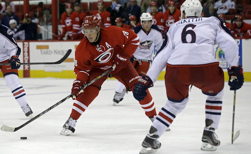 Carolina Hurricanes' Alexander Semin (28), of Russia, controls the puck against Columbus Blue Jackets' Nikita Nikitin (6), of Russia, during the second period of an NHL preseason hockey game in Raleigh, N.C., Wednesday, Sept. 18, 2013. (AP Photo/Gerry Broome)