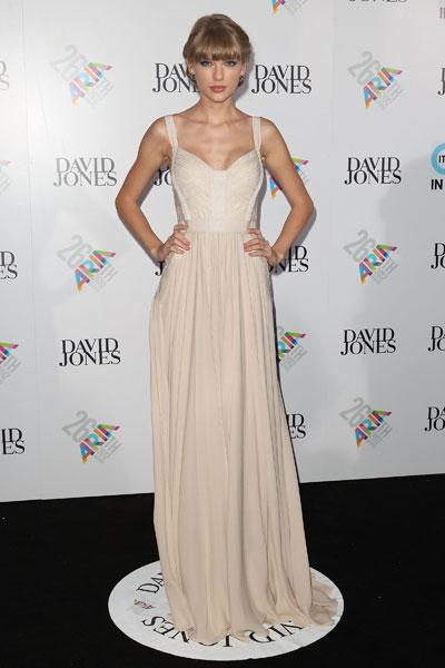 "<b>Taylor Swift </b><br><br>The country star looked radiant in this nude Elie Saab SS13 gown with cut-out detail at the ARIA Awards 2012 in Sydney.<br><br><a target=""_blank"" href=""http://uk.lifestyle.yahoo.com/photos/top-10-best-dressed-celebrities-this-week-16-22-nov-slideshow/taylor-swift-photo-766457011.html""><b>Taylor Swift – best dressed celebrity</b><br></a><br>Image © Getty"