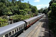 """<p>The <a href=""""https://www.ksr.com.au/Pages/Default.aspx"""" rel=""""nofollow noopener"""" target=""""_blank"""" data-ylk=""""slk:Kuranda Scenic Railway"""" class=""""link rapid-noclick-resp"""">Kuranda Scenic Railway</a> is a two-hour journey that begins in the coastal city of Cairns and ends in the town of Kuranda. Along the way, you'll experience waterfalls, mountains, and hundreds of species of flowers, trees, and wildlife, as well as one of the world's oldest rainforests, located in Queensland, Australia.</p>"""