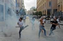 Lebanese protesters clash with security forces in the vicinity of the parliament in central Beirut following the deadly Beirut port explosion