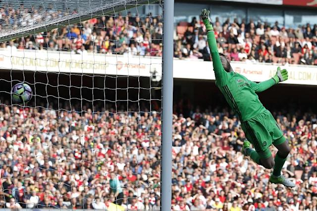 Manchester United's Spanish goalkeeper David de Gea cannot prevent Arsenal's midfielder Granit Xhaka's deflected shot beating him for the opening goal of the English Premier League football match at the Emirates Stadium in London on May 7, 2017 (AFP Photo/Ian KINGTON)