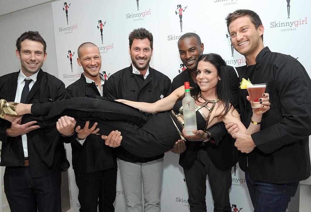 "The original Skinnygirl Bethenny Frankel strikes a pose with former ""bachelors"" Graham Bunn and J.P. Rosenbaum, dancer Maksim Chmerkovskiy, model Tyson Beckford, and former ""bachelor"" Chris Bukowski, left to right, at the Skinnygirl Cocktails ?Meet the New Girls? launch party, Thursday, April 18, 2013 in New York. The star-studded group served as the evening?s mixologists, pouring the four new innovations from Skinnygirl Cocktails and donating all of their tips to Dress for Success. (Diane Bondareff/Invision for Skinnygirl Cocktails/AP Images)"