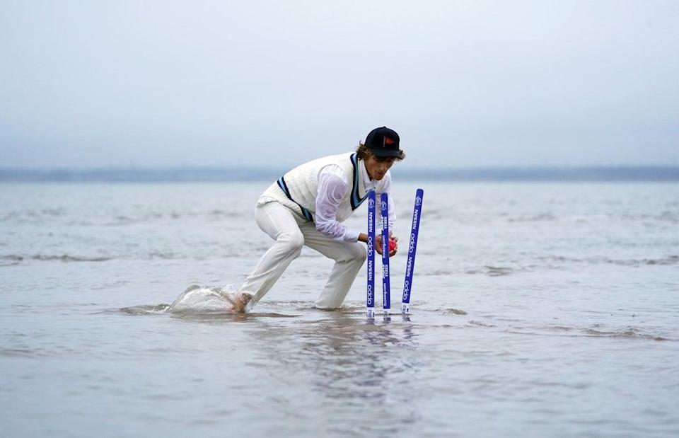 The stumps are broken as they start to submerge (Andrew Matthews/PA) (PA Wire)