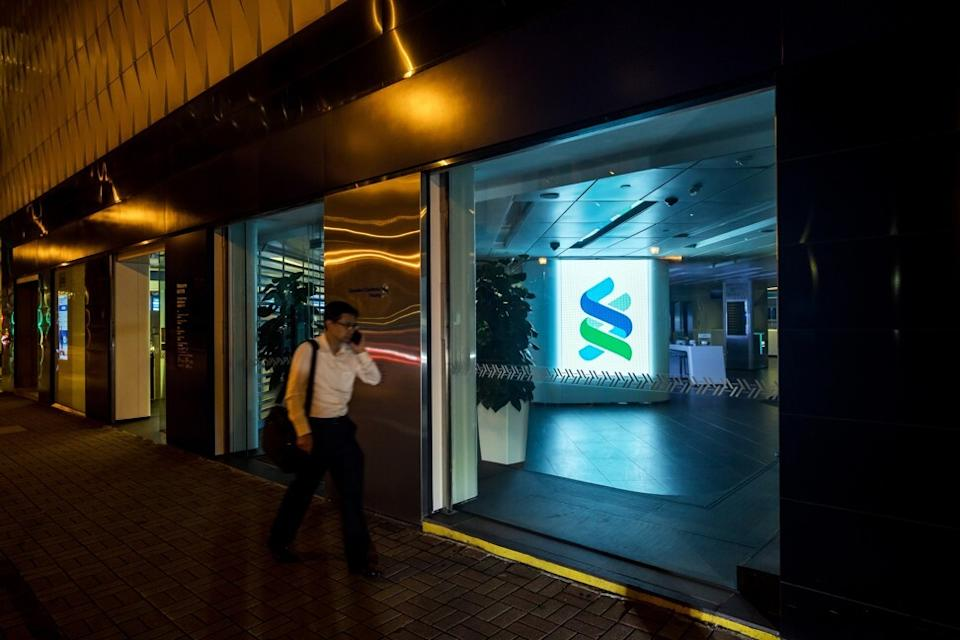 Standard Chartered expects lower impairment costs for potential soured loans in the second half of the year. Photo: Bloomberg