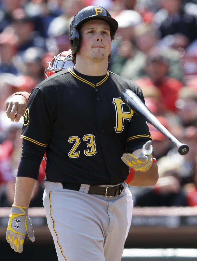 Pittsburgh Pirates' Travis Snider (23) flips his bat after striking out against Cincinnati Reds starting pitcher Johnny Cueto in the ninth inning of a baseball game, Wednesday, April 16, 2014, in Cincinnati. Cueto struck out 12 batters in the game won by Cincinnati 4-0. (AP Photo/Al Behrman)