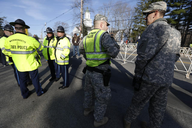 Massachusetts State Police and military police gather before the start of the 118th Boston Marathon Monday, April 21, 2014 in Hopkinton, Mass. (AP Photo/Michael Dwyer)