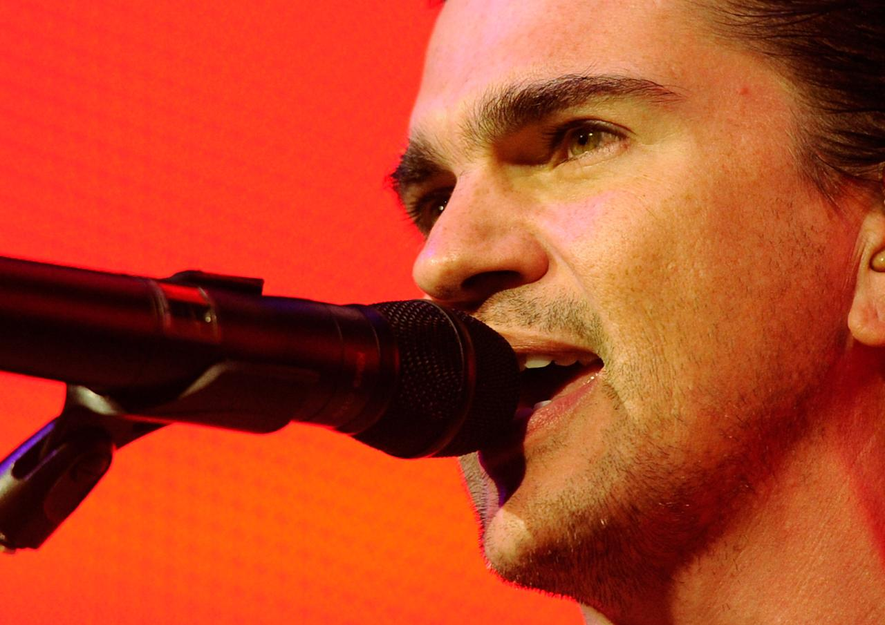 """LAS VEGAS, NV - MARCH 18:  Colombian singer/songwriter Juanes performs at The Joint inside the Hard Rock Hotel & Casino as he tours in support of his latest album, """"P.A.R.C.E."""" March 18, 2011 in Las Vegas, Nevada.  (Photo by Ethan Miller/Getty Images)"""