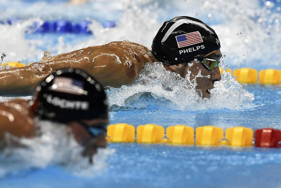 United States' Ryan Lochte and United States' Michael Phelps, right, compete during a men's 200-meter individual medley semifinal during the swimming competitions at the 2016 Summer Olympics, Wednesday, Aug. 10, 2016, in Rio de Janeiro, Brazil. (AP Photo/Martin Meissner)