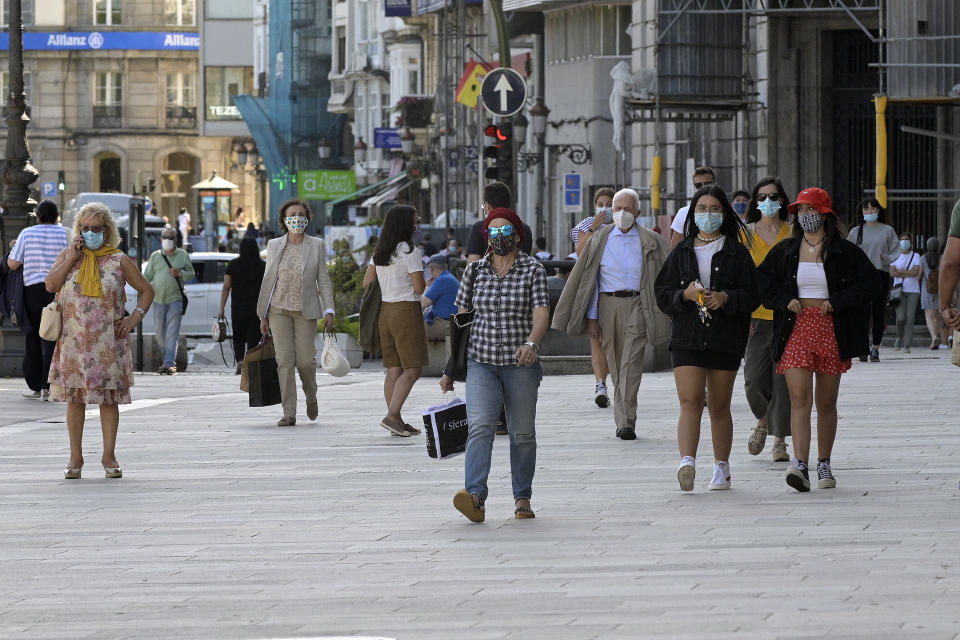 "A CORUÑA, SPAIN - AUGUST 13: People are seen walking on the first day of the ban on smoking on public roads in Galicia on August 13, 2020 in A Coruña, Spain. As explained yesterday by the president of the Xunta, Alberto Núñez Feijóo, experts consider that tobacco smoke is ""a factor in the spread"" of the virus. Andalusia, Castilla y Leon and Castilla-La Mancha are also studying this restriction. (Photo by M. Dylan/Europa Press via Getty Images)"