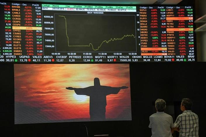 Despite attempts to soothe markets with massive stimulus pledges and rate cuts, more countries are going into lockdown bringing the world economy juddering to a halt (AFP Photo/Nelson ALMEIDA)
