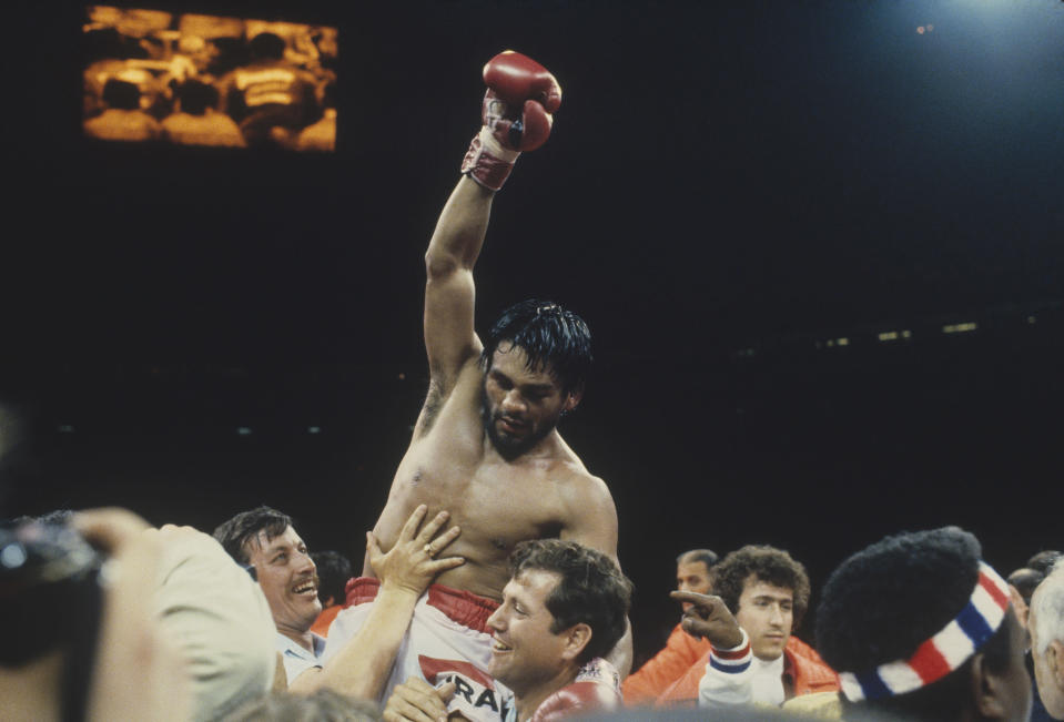 """Roberto Duran celebrates in the ring after he defeated """"Sugar"""" Ray Leonard during their fight at The Forum in Montreal, Canada on June 20, 1980. Roberto Duran won on a 15-round decision to win the WBC welterweight title. (Photo by Focus on Sport via Getty Images)"""