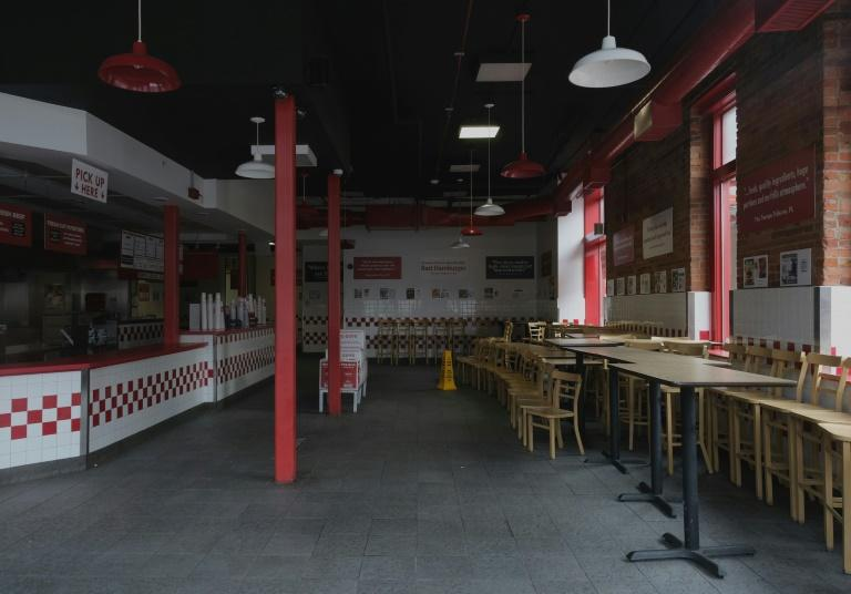 Fast food outlets in the United States are offering takeout, but their sit-down service is mostly over for the time being -- this Five Guys in Detroit is totally closed (AFP Photo/SETH HERALD)
